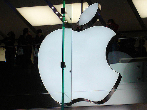 apple logo behind glass
