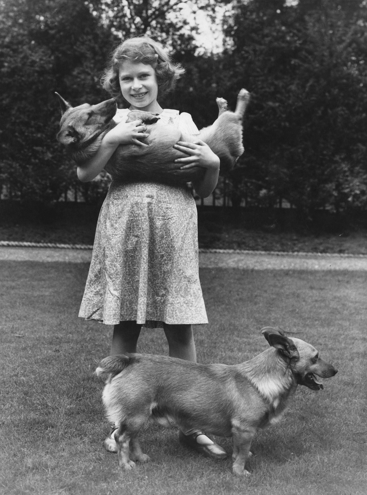 Princess Elizabeth (now Queen Elizabeth II) with two corgi dogs at her home at 145 Piccadilly, London, July 1936.